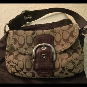 Never used Coach Soho Signature purse.